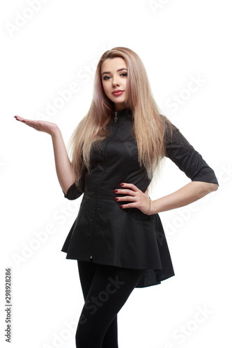 Nice blonde girl in black clothes holds her hand with an open palm Isolated on a white background Tablou Canvas