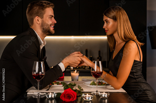 Fototapeta Pleased happy married couple having romantic dinner in candlelight obraz