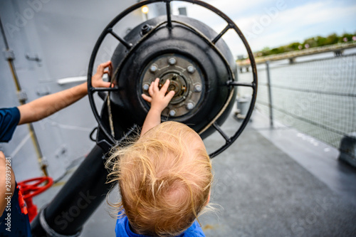Photo Child pointing at Mechanical setting for anti-submarine depth charge