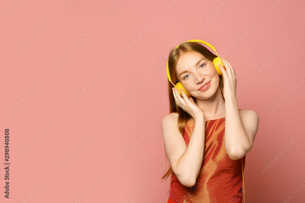 Fototapety, obrazy: Portrait of beautiful young woman with headphones on pink background, space for text