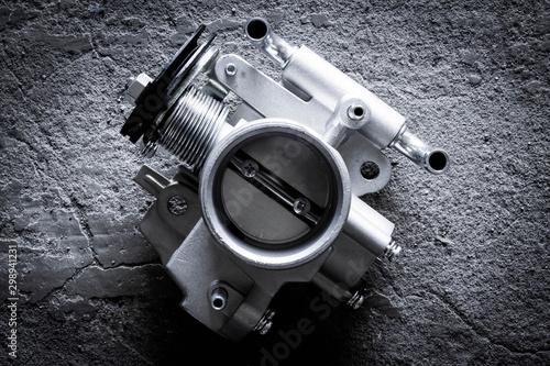 new car throttle valve on white background