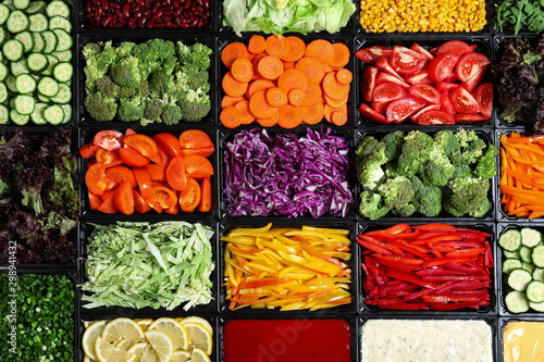 Photo Salad bar with different fresh ingredients as background, top view