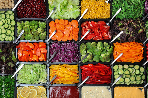 Fotografia  Salad bar with different fresh ingredients as background, top view
