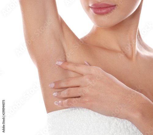 Young woman showing armpit on white background, closeup Canvas Print