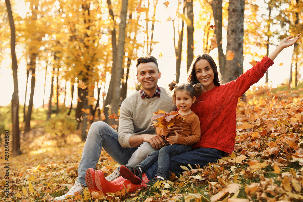 Fototapety, obrazy: Happy family with little daughter in park. Autumn walk