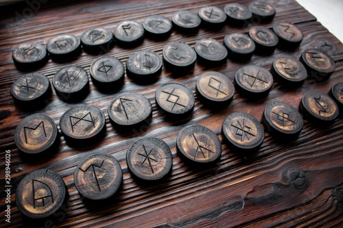 Photo Set of anglo-saxon runes carved in wood - anglo-saxon futhark (futhorc)