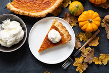 Portion Of Homemade Thanksgiving Pie With Whipped Cream