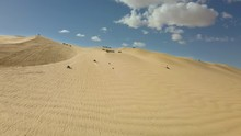 ATVs Driving Off Road On Glamis Sand Dunes In California, Lateral Aerial