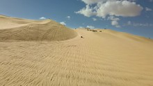 Aerial Lateral Of Dune Buggies Driving On Sand Dunes In California