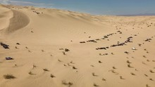 Off Road Driving On Glamis Sand Dunes In California, Aerial Pull Out