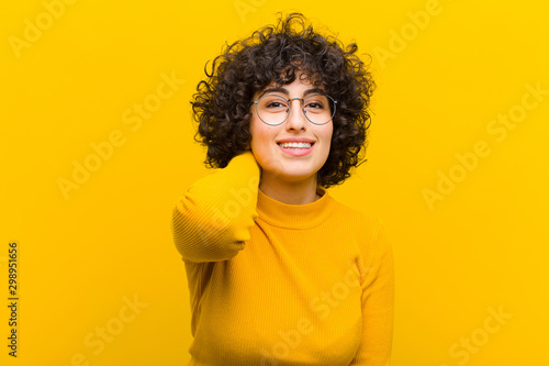 Carta da parati  young pretty afro woman laughing cheerfully and confidently with a casual, happy