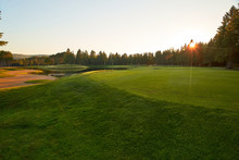 Sunset At The Golf Course - The Sun Sets On A Putting Green At The Golf Course In Autumn