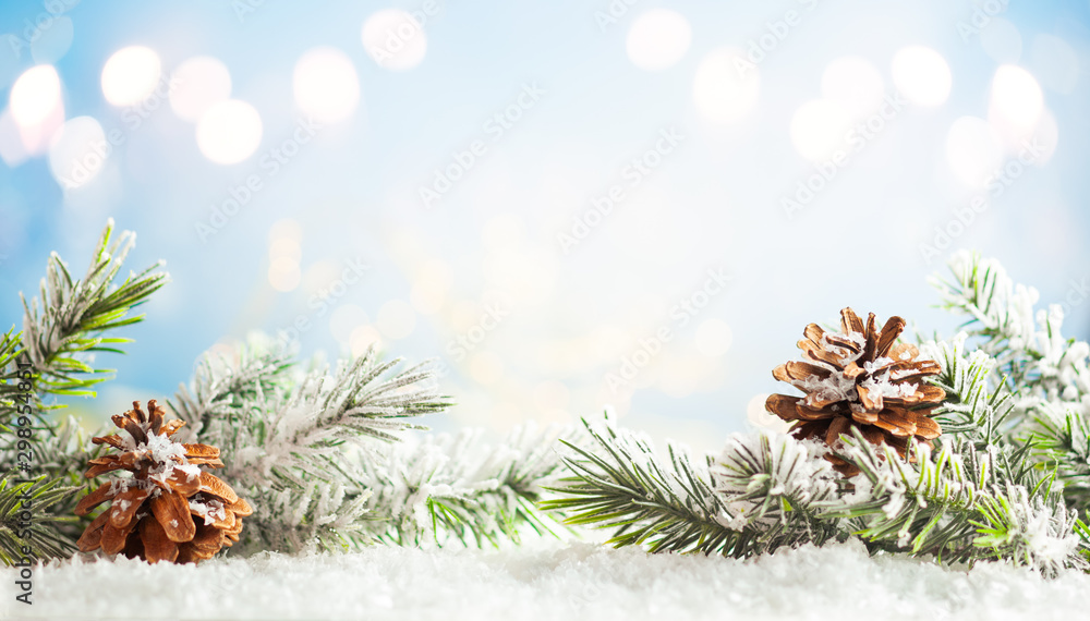 Fototapety, obrazy: Christmas fir tree branches with pine cones on blurred blue .background. Christmas and Winter concept..