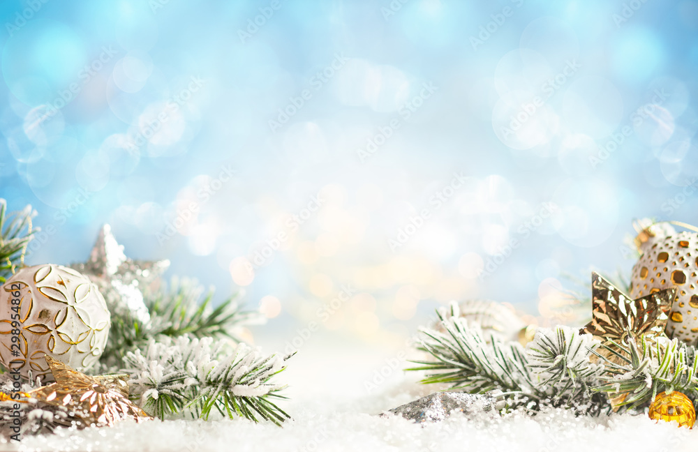 Fototapeta Christmas winter background with Christmas baubles and fir tree branches on snow.