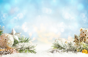 Fototapeta na wymiar Christmas winter background with Christmas baubles and fir tree branches on snow.