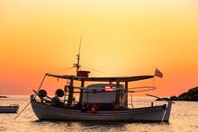 Fishing Boat With Greece Flag, Beautiful Sunrise On Background