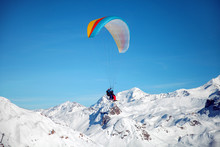 Tandem Of Skiers With Paraglid...