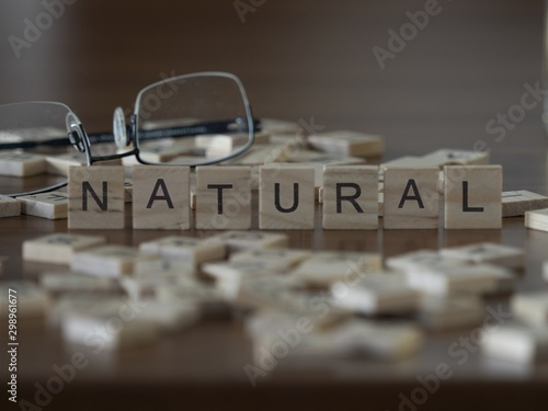 Photo  The concept of Natural represented by wooden letter tiles