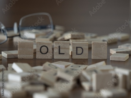 Valokuvatapetti The concept of Old represented by wooden letter tiles