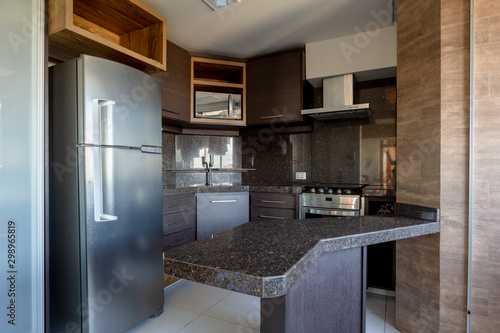 Fotografie, Obraz  Kitchen with silver fridge, stove and microwave