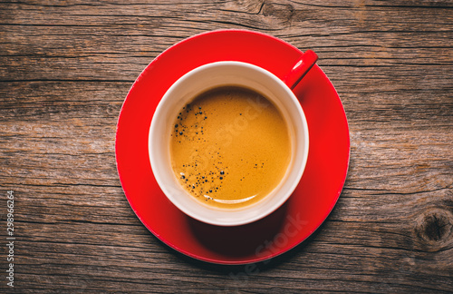 Wall Murals Cafe Cup of aromatic black coffee on a wooden background.