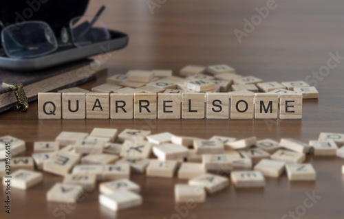 The concept of Quarrelsome represented by wooden letter tiles Canvas-taulu