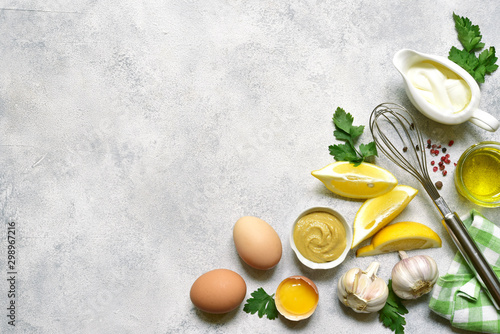 Ingredients for making mayonnaise salad dressing. Top view with copy space.