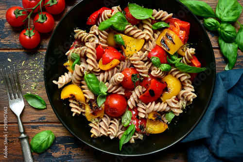 Whole wheat fusilli pasta with grilled vegetables. Top view with copy space.
