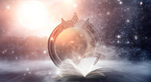 An Open Book And A Magic Mirror Against The Backdrop Of A Night Landscape. Abstract Dark Scene, Mystical Background, Fantasy.