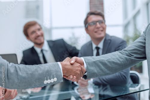 Fototapeta handshake of business people on a blurred office background. obraz na płótnie
