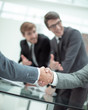 close up. business handshake in a modern office .