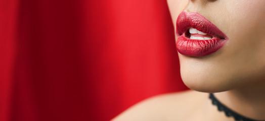 women with beautiful red li...