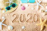 Fototapeta Kawa jest smaczna - 2020 text in the sand with beach accessories