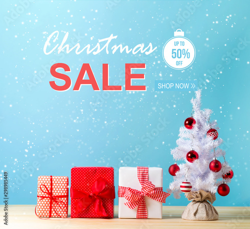 Fototapety, obrazy: Christmas sale message with a white Christmas tree and gift boxes