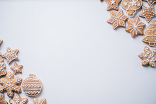 Christmas Background With Homemade Gingerbread Cookies On White Table, Copy Space. Festive Food, New Year Celebration Traditions