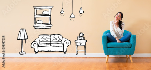 New apartment dream with woman in a thoughtful pose in a chair Fototapeta