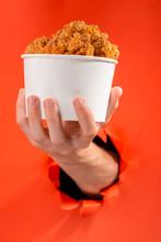 Hand Offering Chicken Nuggets