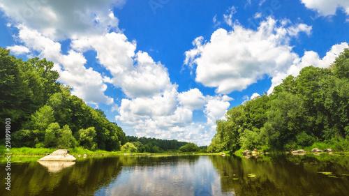 Foto auf Gartenposter Himmelblau Huge stone on the beautiful river Sluch, Ukraine