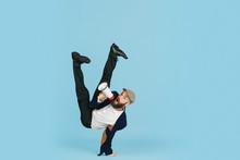 Young Caucasian Businessman Having Fun Dancing Break Dance On Blue Studio Background. Management, Flexible, Freedom, Professional Occupation, Alternative Way Of Modern Working. Loves His Job