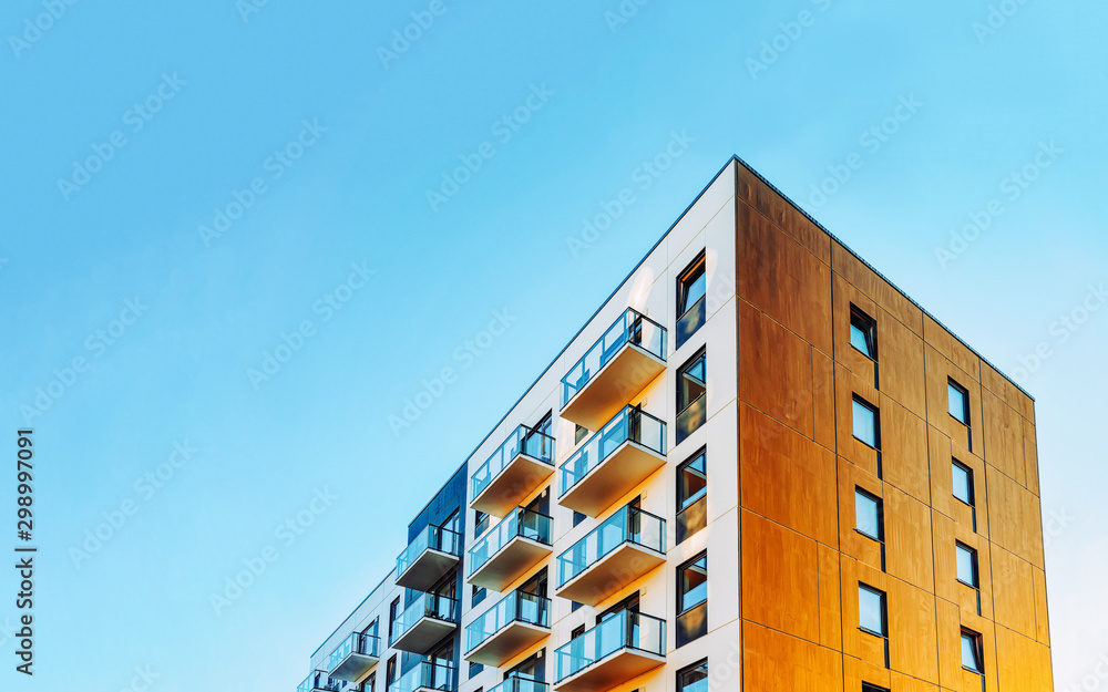 Fototapeta Part of Modern residential apartment with flat building exterior