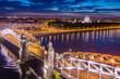 Saint-Petersburg. Russia. Bird's-eye view of Bolsheokhtinsky bridge. Peter the Great bridge with evening lighting. Bridges Of St. Petersburg. Rivers Of St. Petersburg. Lights are reflected in the Neva