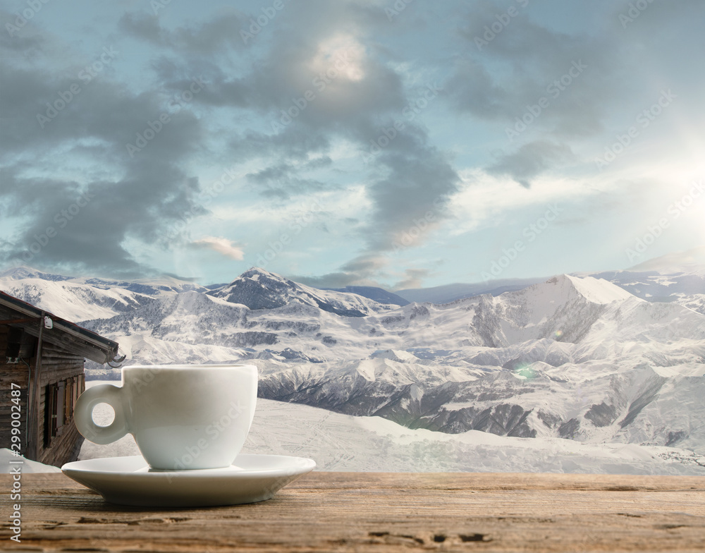 Fototapety, obrazy: Single tea or coffee mug and landscape of mountains on background. Cup of hot drink with snowly look and cloudly sky in front of it. Warm in winter day, holidays, travel, New Year and Christmas time.