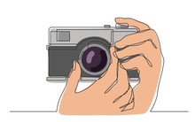 Continuous Line Drawing Of Hand Holding Photo Camera Making Pictures