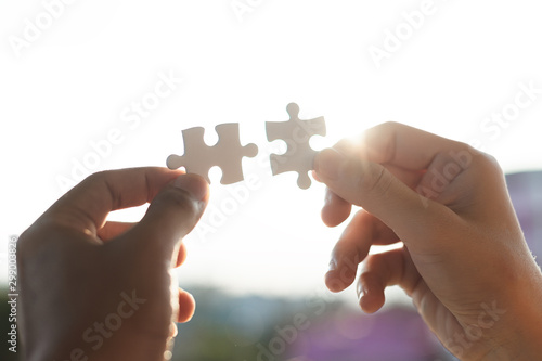 Connect jigsaw pieces to create network connection silhouette sunset, Business concept Fototapet