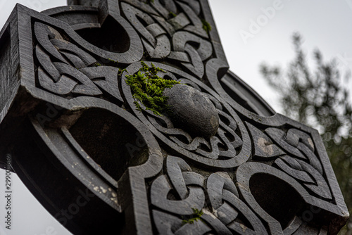 Wonderful embossed Celtic stone cross, full of details and textures in its elaborate carvings and lichen growing Canvas Print