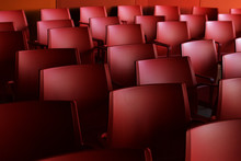 Red Chairs In A Large Room. Rows Of Chairs
