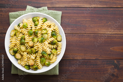 Garden Poster Brussels Fresh homemade pasta carbonara with roasted Brussels sprouts and freshly ground black pepper in bowl, photographed overhead with copy space on the right side (Selective Focus, Focus on the dish)