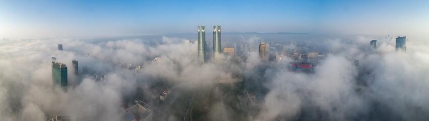 A City shrouded in fog in t...