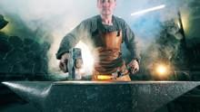 Working Blacksmith Shaping Hot...