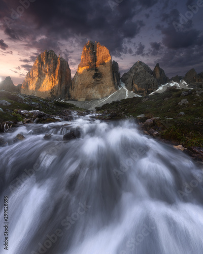 Sunset at a River in Tre Cime di Lavaredo Drei Zinnen Dolomites Tyrol Italy - 299028696